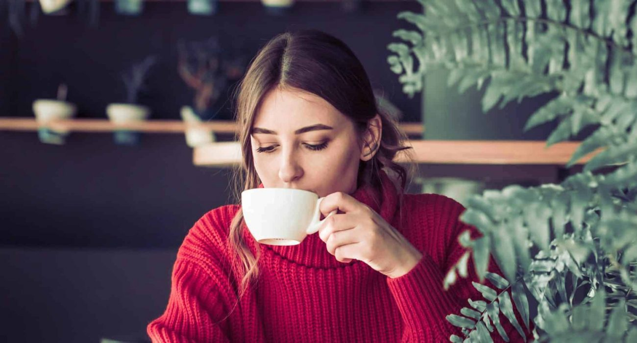 woman drinking coffee first thing in the morning
