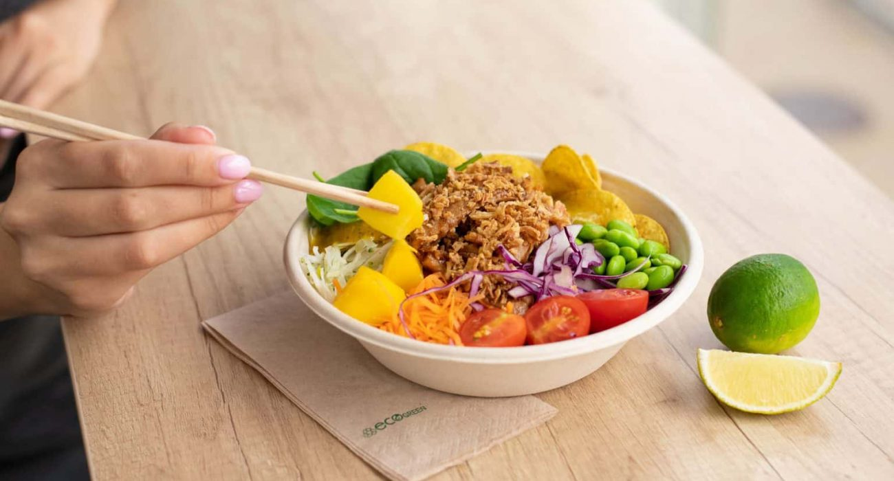 person-eating-bowl-of-salad-1484523